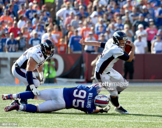 Denver Broncos quarterback Trevor Siemian sacked by Buffalo Bills defensive tackle Kyle Williams late in the fourth quarter on September 24 2017 at...