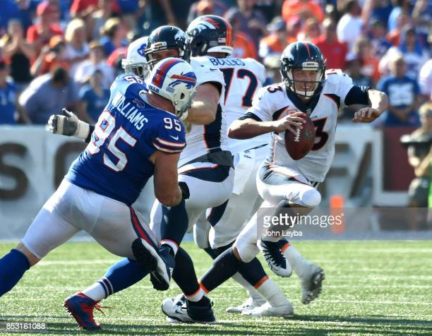Denver Broncos quarterback Trevor Siemian scramble out of the pocket as he is chased by Buffalo Bills defensive tackle Kyle Williams late in the...