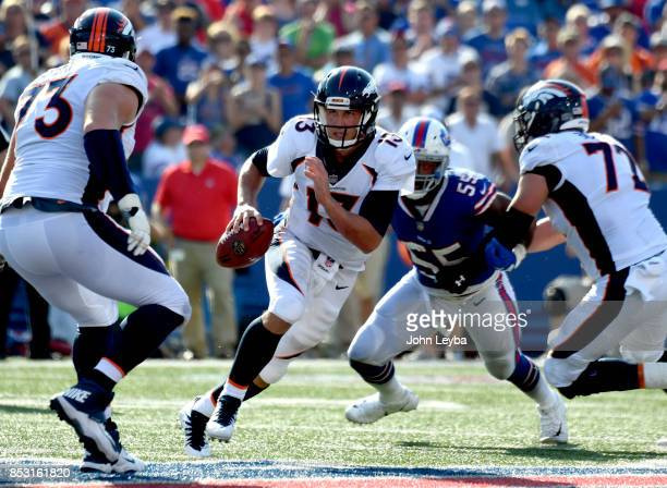 Denver Broncos quarterback Trevor Siemian scramble out of the pocket against the Buffalo Bills late in the fourth quarter on September 24 2017 at New...