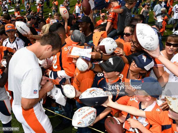 Denver Broncos quarterback Trevor Siemian signs autographs after scrimmage at Dove Valley August 05 2017
