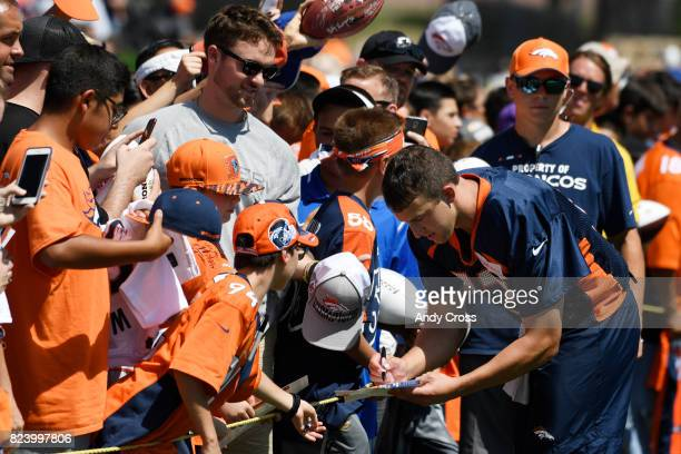 Denver Broncos quarterback Trevor Siemian signs autographs after day two of trading camp at Dove Valley July 28 2017