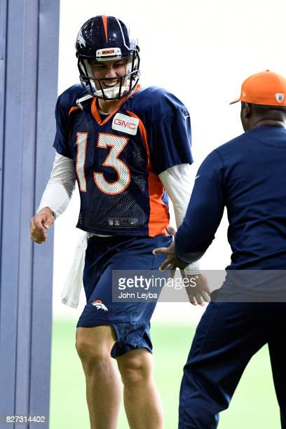 Denver Broncos quarterback Trevor Siemian smiles at Denver Broncos head coach Vance Joseph as he enters the indoor practice facility The team moved...