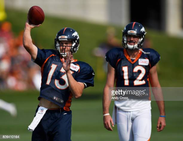 Denver Broncos quarterback Trevor Siemian throws during drills with Denver Broncos quarterback Paxton Lynch at Dove Valley August 04 2017