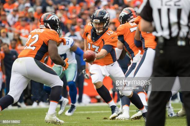 Denver Broncos quarterback Trevor Siemian turns to hand the ball to running back CJ Anderson during a game between the Denver Broncos and the Dallas...