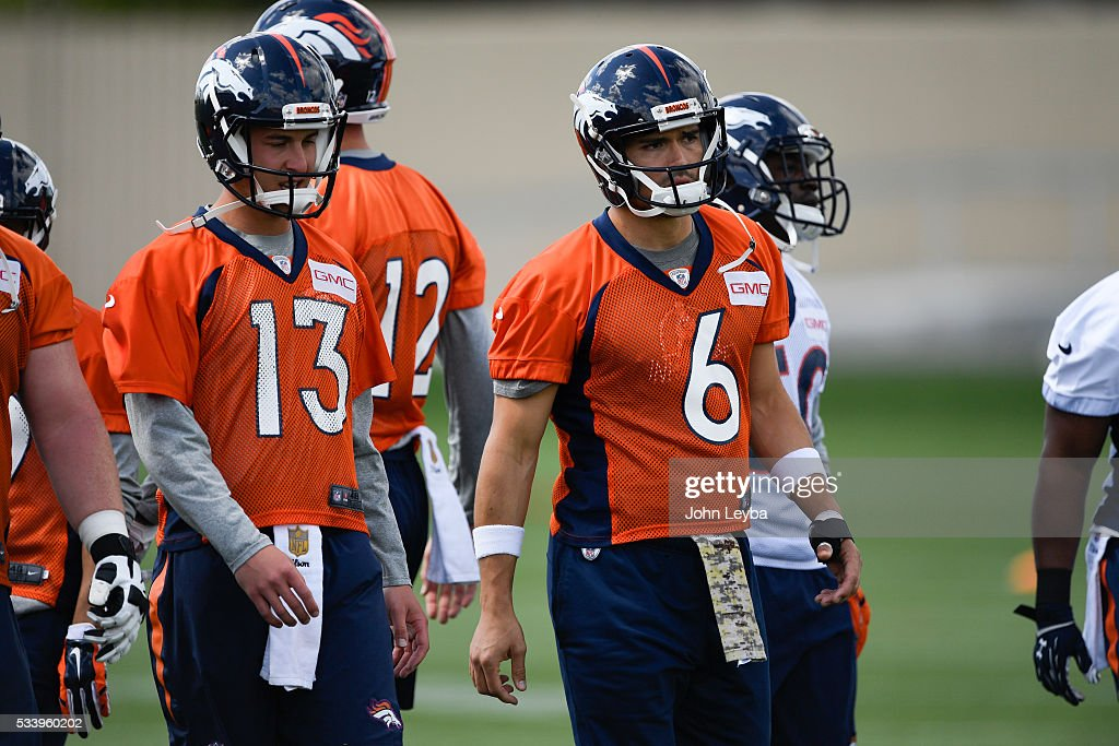 Denver Broncos quarterback Trevor Simian (13) and <a gi-track='captionPersonalityLinkClicked' href=/galleries/search?phrase=Mark+Sanchez&family=editorial&specificpeople=690406 ng-click='$event.stopPropagation()'>Mark Sanchez</a> (6) prepare for stretching during OTA's May 24, 2016 at UCHealth Training Facility.