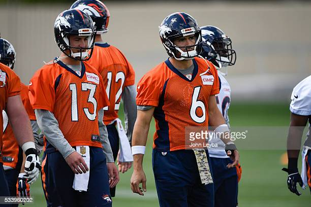 Denver Broncos quarterback Trevor Simian and Mark Sanchez prepare for stretching during OTA's May 24 2016 at UCHealth Training Facility