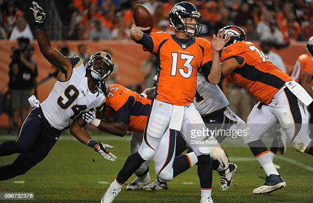 Denver Broncos quarterback Trevor Simian gets a pass off out of the pocket in the second quarter at Sports Authority Field at Mile High on Saturday...