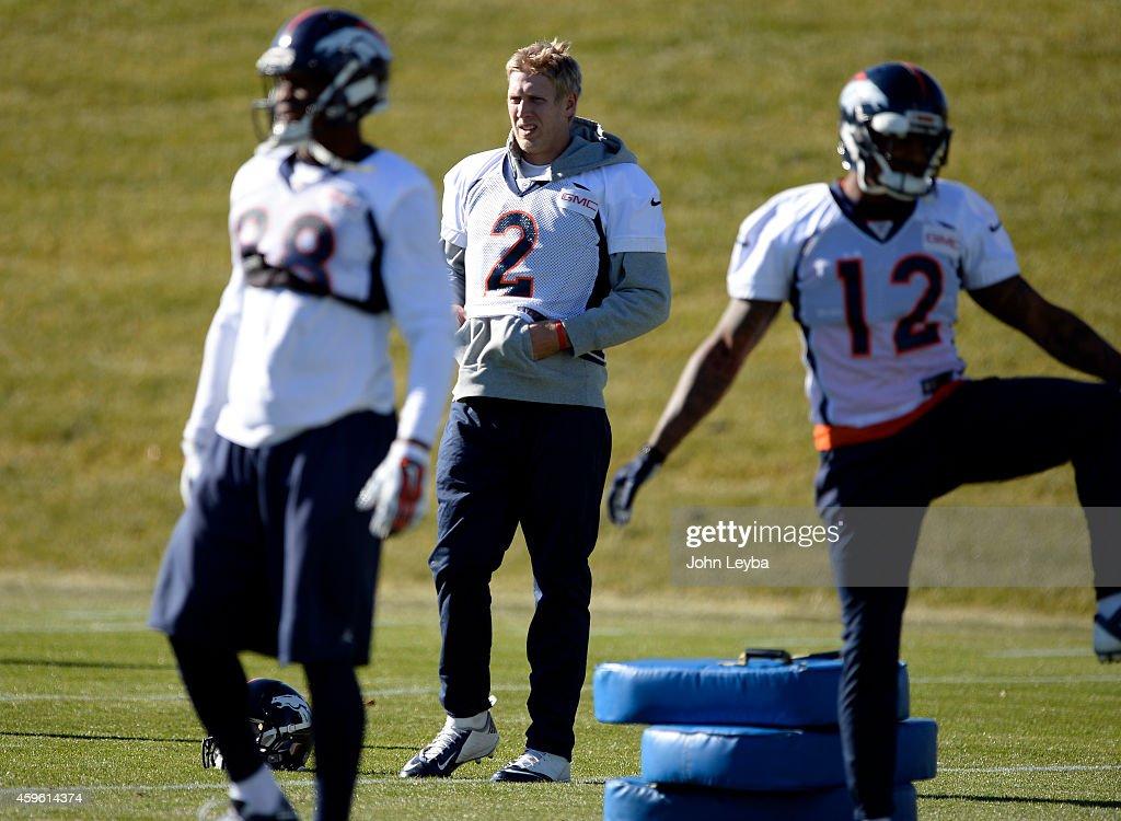 Denver Broncos quarterback Zac Desert (2) stretches during practice November 26, 2014 at Dove Valley.