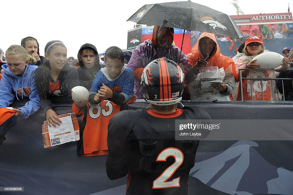 Denver Broncos quarterback <a gi-track='captionPersonalityLinkClicked' href=/galleries/search?phrase=Zac+Dysert&family=editorial&specificpeople=7172634 ng-click='$event.stopPropagation()'>Zac Dysert</a> (2) signs autographs after a soggy practice on day six of the Denver Broncos 2014 training camp July 30, 2014 at Sports Authority Field at Mile High Stadium.