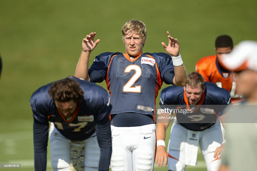 Denver Broncos quarterback <a gi-track='captionPersonalityLinkClicked' href=/galleries/search?phrase=Zac+Dysert&family=editorial&specificpeople=7172634 ng-click='$event.stopPropagation()'>Zac Dysert</a> (2) stretches on day five of the Denver Broncos 2014 training camp July 28, 2014 at Dove Valley.