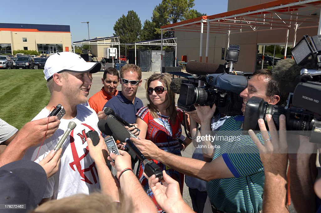 Denver Broncos quarterback Zac Dysert (2) talks with the media after practice August 28, 2013 at Dove Valley.