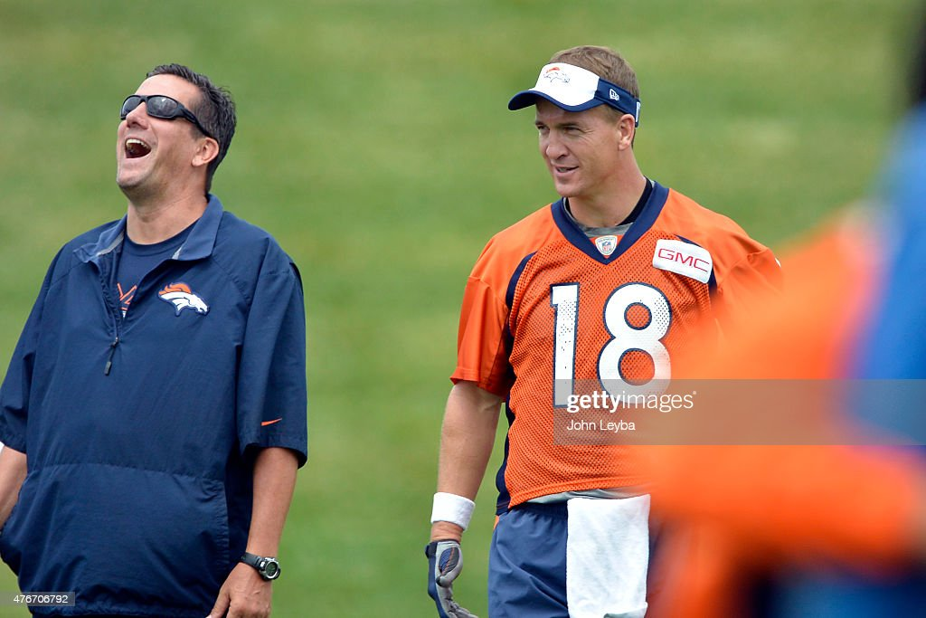 Denver Broncos quarterbacks coach <a gi-track='captionPersonalityLinkClicked' href=/galleries/search?phrase=Greg+Knapp&family=editorial&specificpeople=750404 ng-click='$event.stopPropagation()'>Greg Knapp</a> shares a laugh with Denver Broncos quarterback <a gi-track='captionPersonalityLinkClicked' href=/galleries/search?phrase=Peyton+Manning&family=editorial&specificpeople=184524 ng-click='$event.stopPropagation()'>Peyton Manning</a> (18) during practice at mini camp June 11, 2015 at Dove Valley.