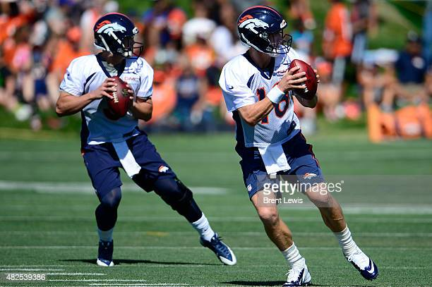 Denver Broncos quarterbacks Trevor Siemian and Peyton Manning run through drills Friday July 31 2015 at Dove Valley in Englewood Colorado This was...