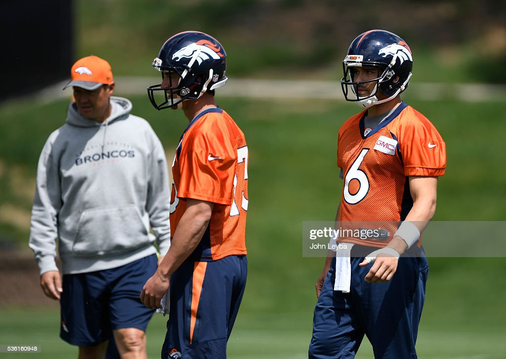 Denver Broncos quarterbacks Trevor Simian (13) and <a gi-track='captionPersonalityLinkClicked' href=/galleries/search?phrase=Mark+Sanchez&family=editorial&specificpeople=690406 ng-click='$event.stopPropagation()'>Mark Sanchez</a> (6) look on during OTA's May 31, 2016 at UCHealth Training Facility, Dove Valley.