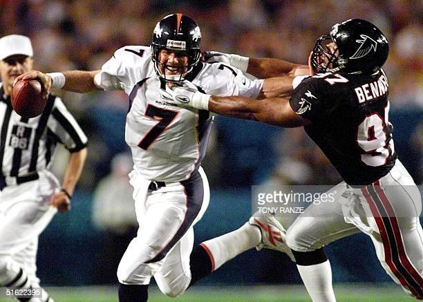 Denver Broncos quaterback John Elway is pursued by Atlanta Falcons linebacker Cornelius Bennett during second half action at Super Bowl XXXIII 31...