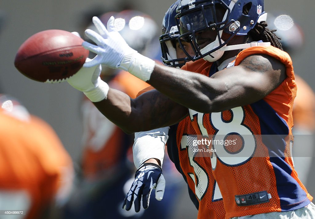 Denver Broncos <a gi-track='captionPersonalityLinkClicked' href=/galleries/search?phrase=Quinton+Carter&family=editorial&specificpeople=5631827 ng-click='$event.stopPropagation()'>Quinton Carter</a> (38) catches a pass as Eric Hagg (37) defends on the play in drills during OTA's June 12, 2014 at Dove Valley.
