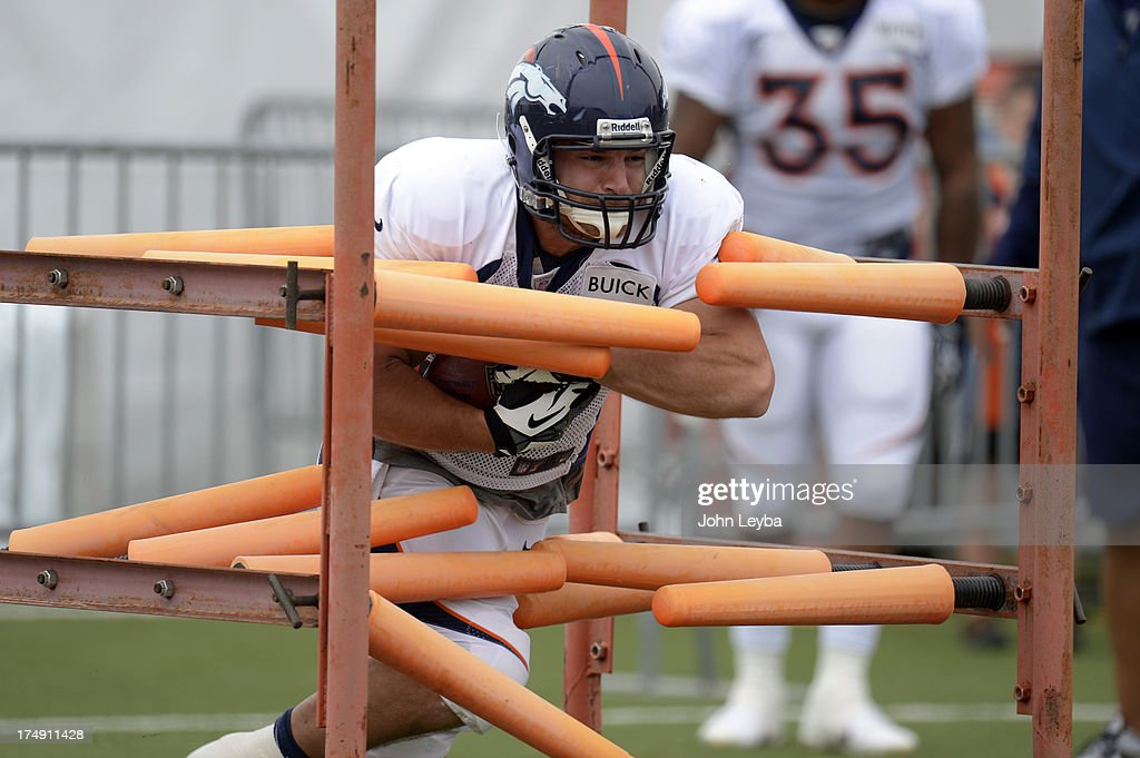 Denver Broncos RB Jacob Hester (22) runs through drills during training camp July 29, 2013 at Dove Valley.
