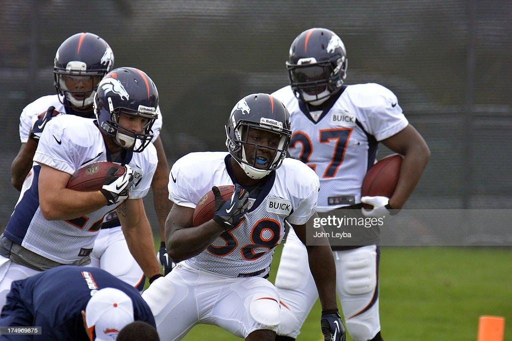Denver Broncos RB's Jacob Hester (22) Montee Ball (38) run through drills during training camp July 29, 2013 at Dove Valley.