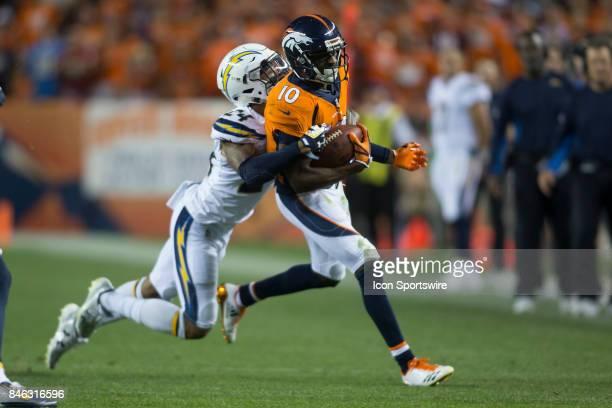 Denver Broncos receiver Emmanuel Sanders is tackled by Los Angeles Chargers cornerback Trevor Williams during the Los Angeles Chargers vs Denver...