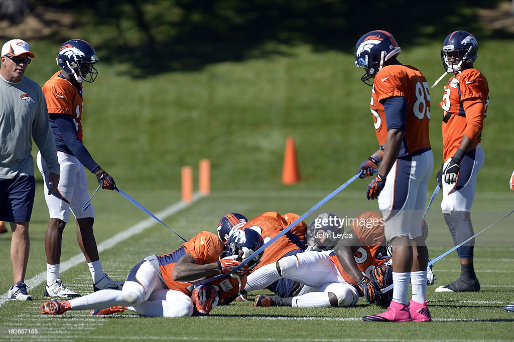 Denver Broncos receivers and running backs work on holding on to the ball during drills at practice October 2, 2013 at Dove Valley.