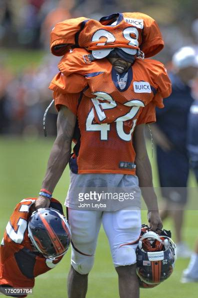 Denver Broncos rookie CB Aaron Hester had the duty of carrying inthe veterans pads after practice during training camp July 31 2013 at Dove Valley
