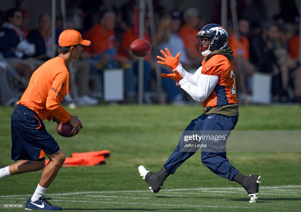 Denver Broncos running back C.J. Anderson (22) catches a pas in drills during training camp on August 8, 2017 in Englewood, Colorado at Dove Valley.