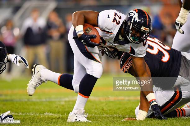 Denver Broncos running back CJ Anderson catches his balance running the ball during the preseason game between the Denver Broncos and the Chicago...