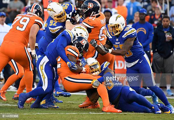 Denver Broncos running back CJ Anderson gets wrapped up by San Diego Chargers linebacker Korey Toomer and San Diego Chargers inside linebacker...