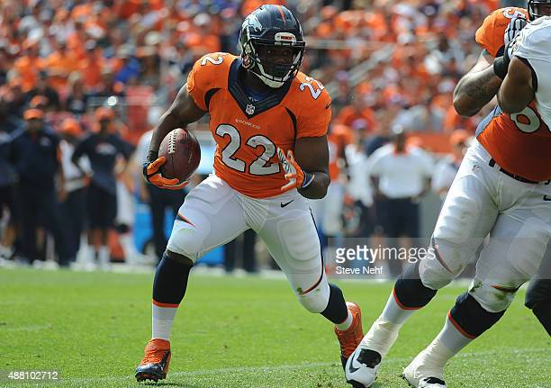 Denver Broncos running back CJ Anderson looks for a hole in the first half against the Baltimore Ravens at Sports Authority Field at Mile High on...