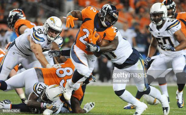 Denver Broncos running back CJ Anderson twists away from the tackle by Los Angeles Chargers linebacker Jatavis Brown in the second quartet at Sports...