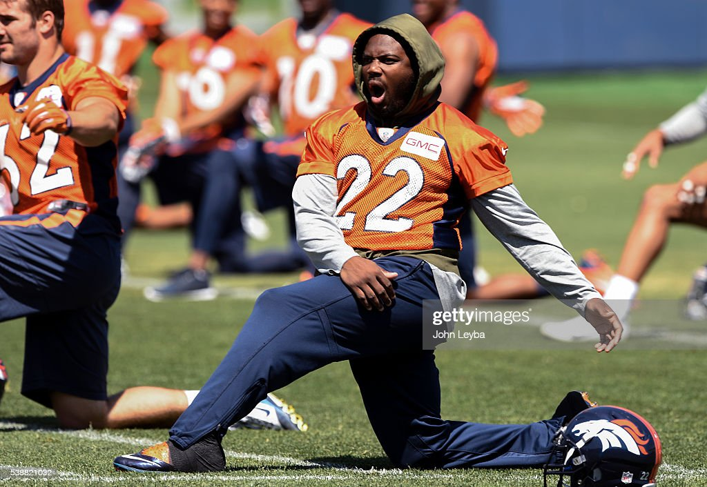 Denver Broncos running back <a gi-track='captionPersonalityLinkClicked' href=/galleries/search?phrase=C.J.+Anderson+-+American+Football+Player&family=editorial&specificpeople=11333631 ng-click='$event.stopPropagation()'>C.J. Anderson</a> (22) yawns at stretching before practice at UCHealth Training Facility during mandatory minicamp June 8, 2016 at Dove Valley.