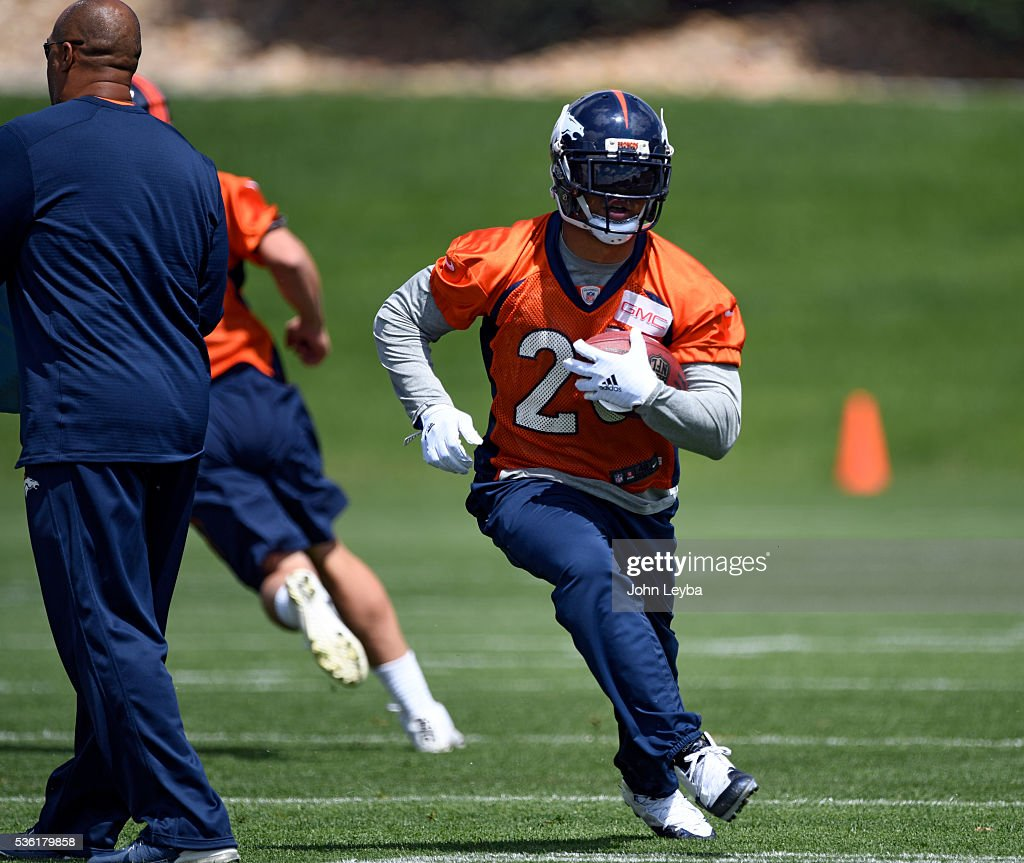 Denver Broncos running back <a gi-track='captionPersonalityLinkClicked' href=/galleries/search?phrase=Devontae+Booker&family=editorial&specificpeople=13592764 ng-click='$event.stopPropagation()'>Devontae Booker</a> (20) turns up field during OTA's May 31, 2016 at UCHealth Training Facility, Dove Valley.