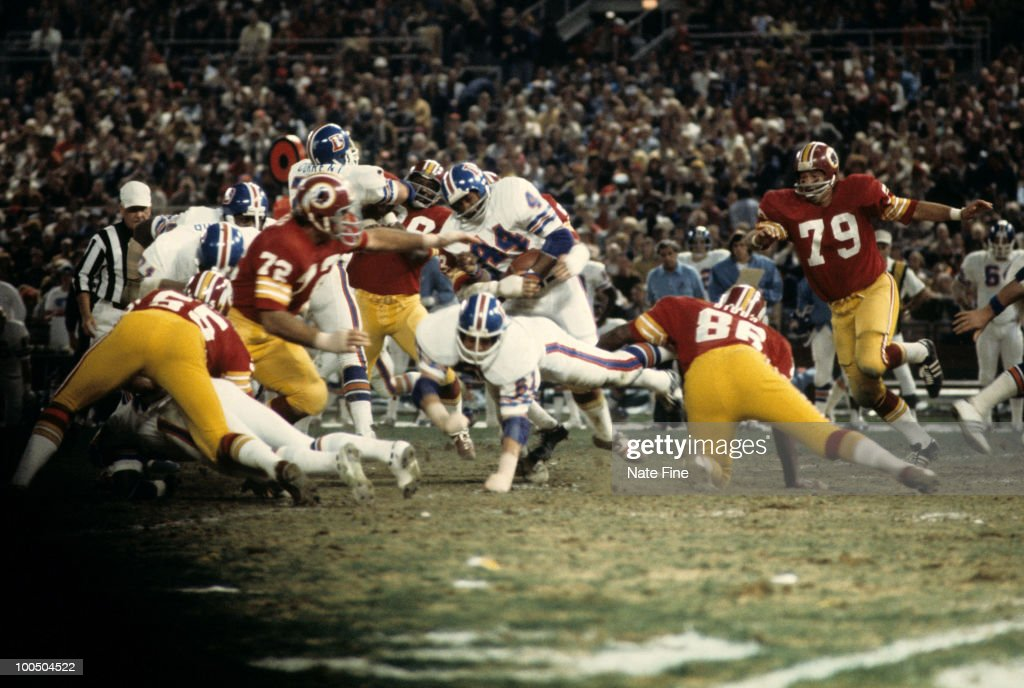 Denver Broncos running back Floyd Little (44) carries the football and looks for room to run during the Broncos 30-3 loss to the Washington Redskins on September 30, 1974 at RFK Stadium in Washington, D.C.