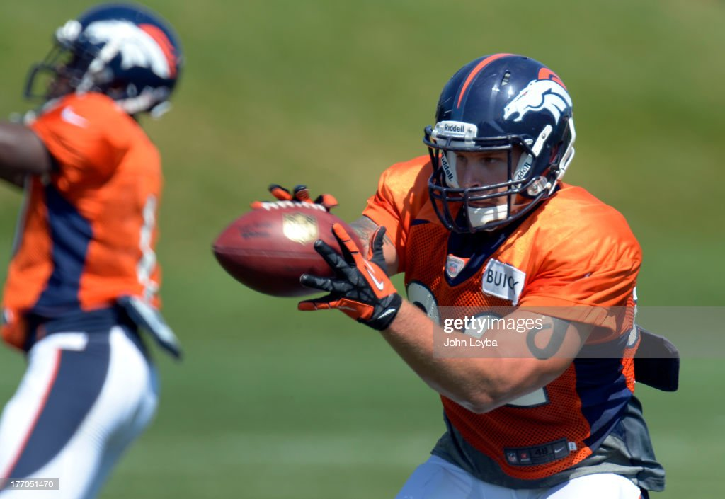 Denver Broncos running back <a gi-track='captionPersonalityLinkClicked' href=/galleries/search?phrase=Jacob+Hester&family=editorial&specificpeople=2109848 ng-click='$event.stopPropagation()'>Jacob Hester</a> (22) ctches a pass during practice August 20, 2013 at Dove Valley