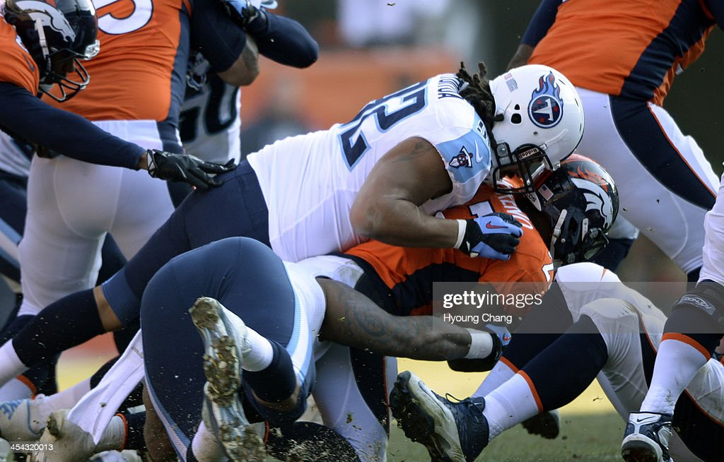 Denver Broncos running back <a gi-track='captionPersonalityLinkClicked' href=/galleries/search?phrase=Knowshon+Moreno&family=editorial&specificpeople=3986554 ng-click='$event.stopPropagation()'>Knowshon Moreno</a> (27) gets taken down by Tennessee Titans defensive end <a gi-track='captionPersonalityLinkClicked' href=/galleries/search?phrase=Ropati+Pitoitua&family=editorial&specificpeople=3955458 ng-click='$event.stopPropagation()'>Ropati Pitoitua</a> (92) and Tennessee Titans defensive tackle Jurrell Casey (99) during the first quarter. The Denver Broncos vs. the Tennessee Titans at Sports Authority Field at Mile High in Denver on December 8, 2013.