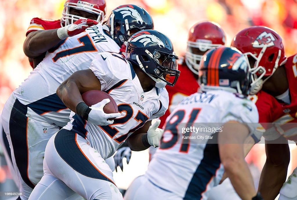 Denver Broncos running back Knowshon Moreno (27) runs the ball against the Kansas City Chiefs in the third quarter at Arrowhead Stadium on Sunday, November 25, 2012, in Kansas City, Missouri. The Denver Broncos defeated the Kansas City Chiefs, 17-9.