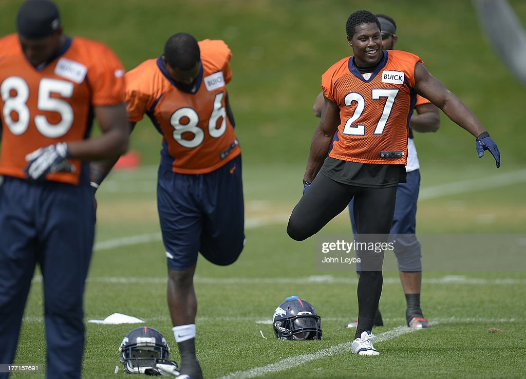 Denver Broncos running back Knowshon Moreno (27) stretches during practice August 22, 2013 at Dove Valley
