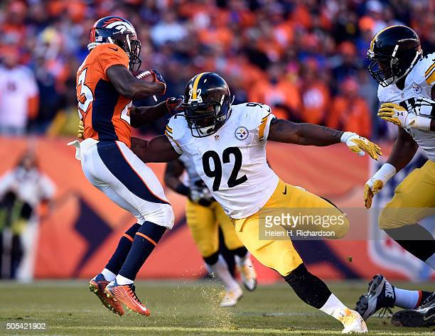 Denver Broncos running back Ronnie Hillman can't escape the arm of Pittsburgh Steelers outside linebacker James Harrison during the first quarter...