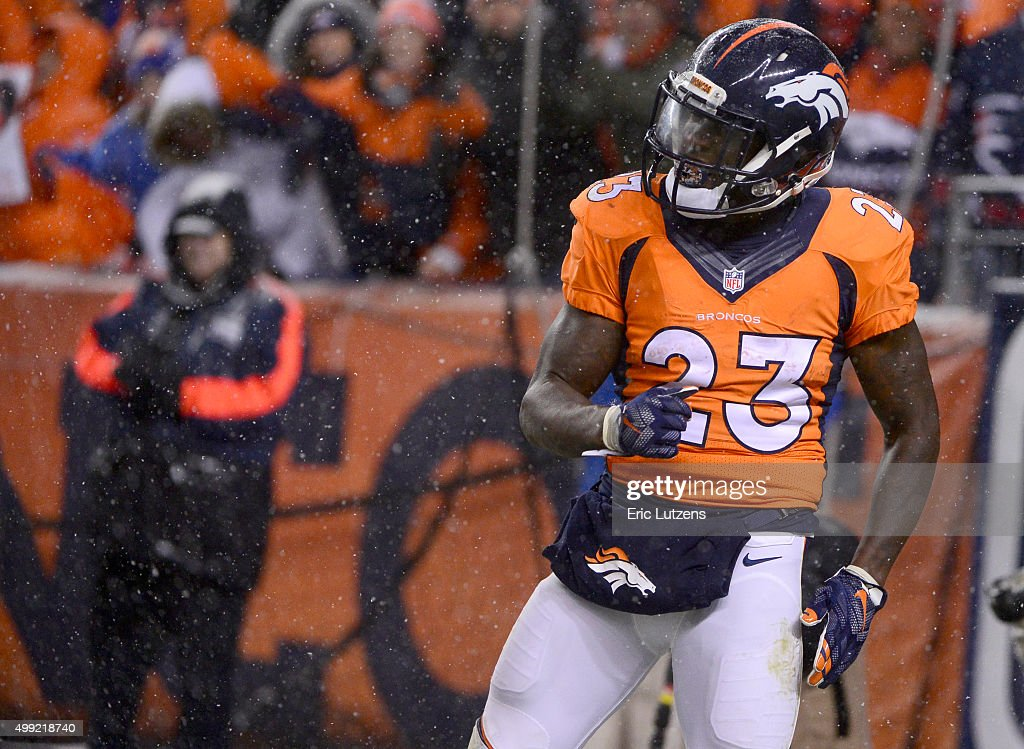 Denver Broncos running back Ronnie Hillman celebrates his touchdown in the second quarter against the New England Patriots November 29 2015 at Sports...