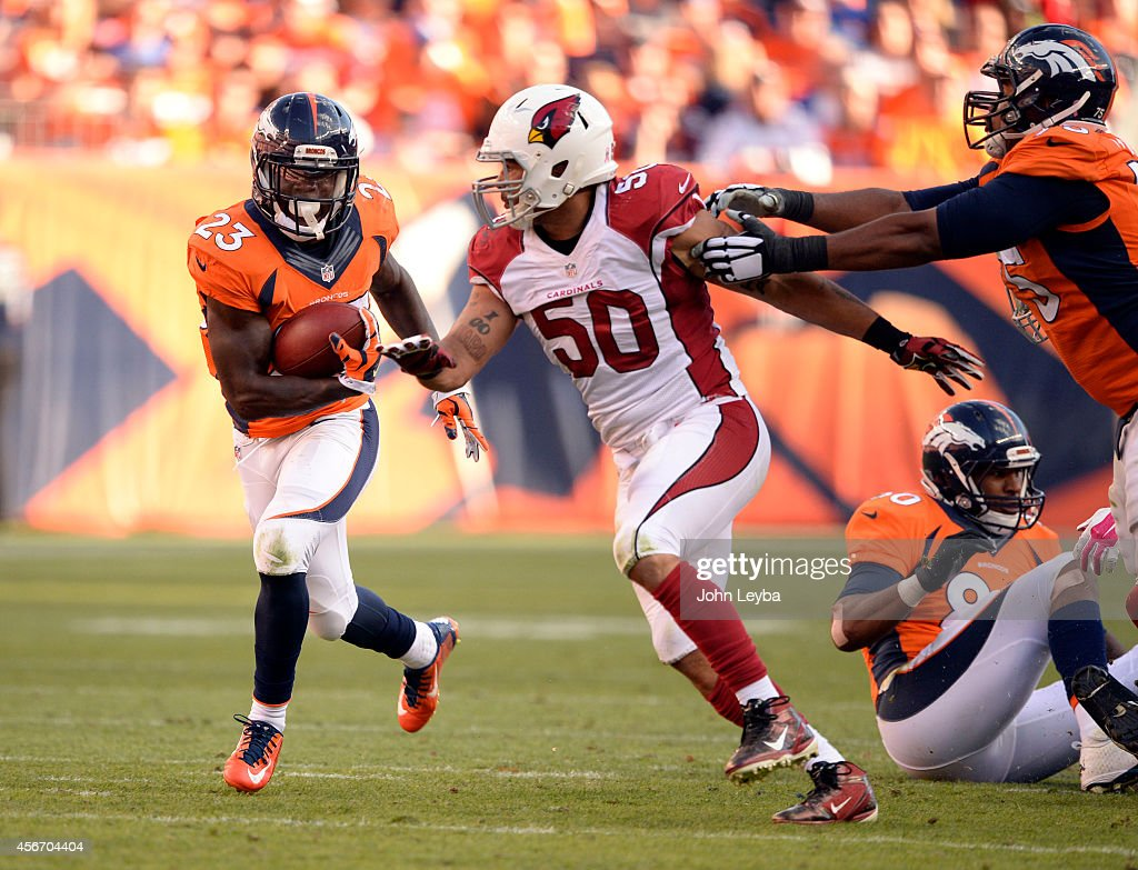 Denver Broncos running back Ronnie Hillman finds a hole as Arizona Cardinals middle linebacker Larry Foote gets blocked by Denver Broncos tackle...