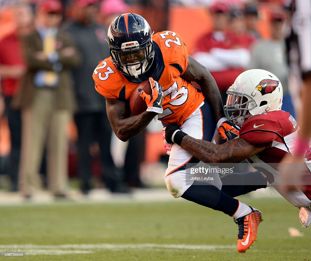 Denver Broncos running back Ronnie Hillman gets caught by Arizona Cardinals free safety Rashad Johnson after a gain during the 4th quarter October 5...