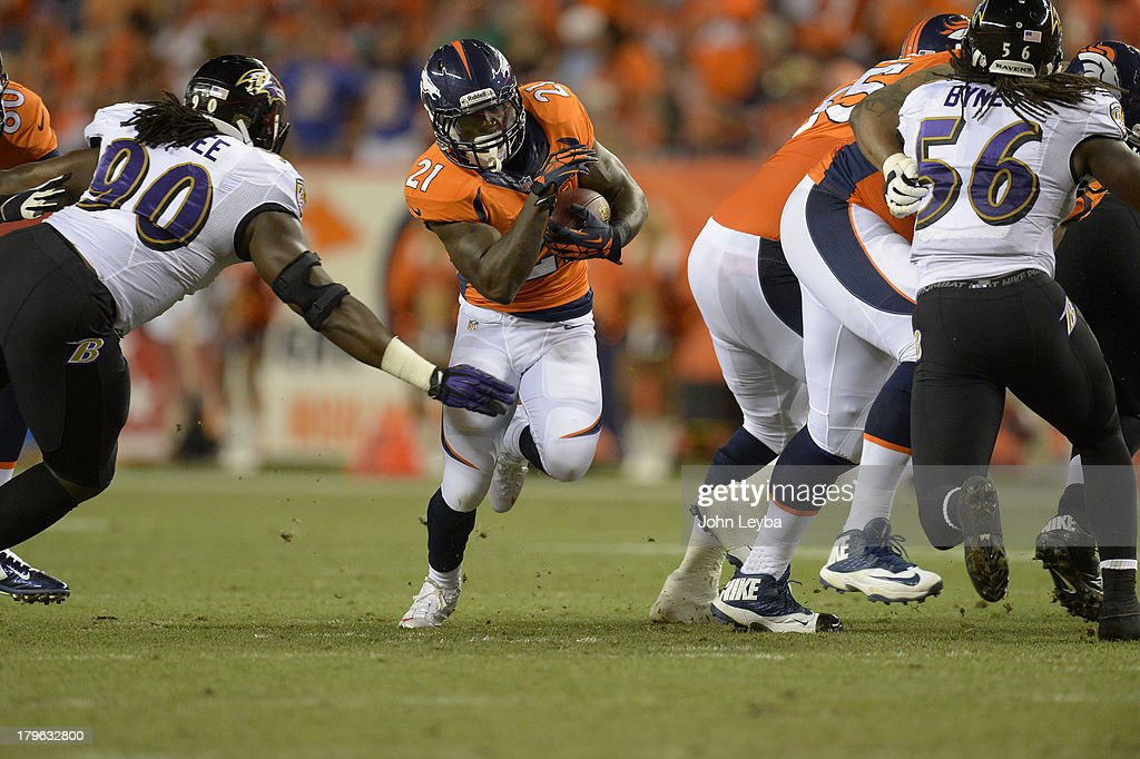 Denver Broncos running back Ronnie Hillman (21) runs through a hole in the line in the third quarter. The Denver Broncos took on the Baltimore Ravens in the first game of the 2013 season at Sports Authority Field at Mile High in Denver on September 5, 2013.