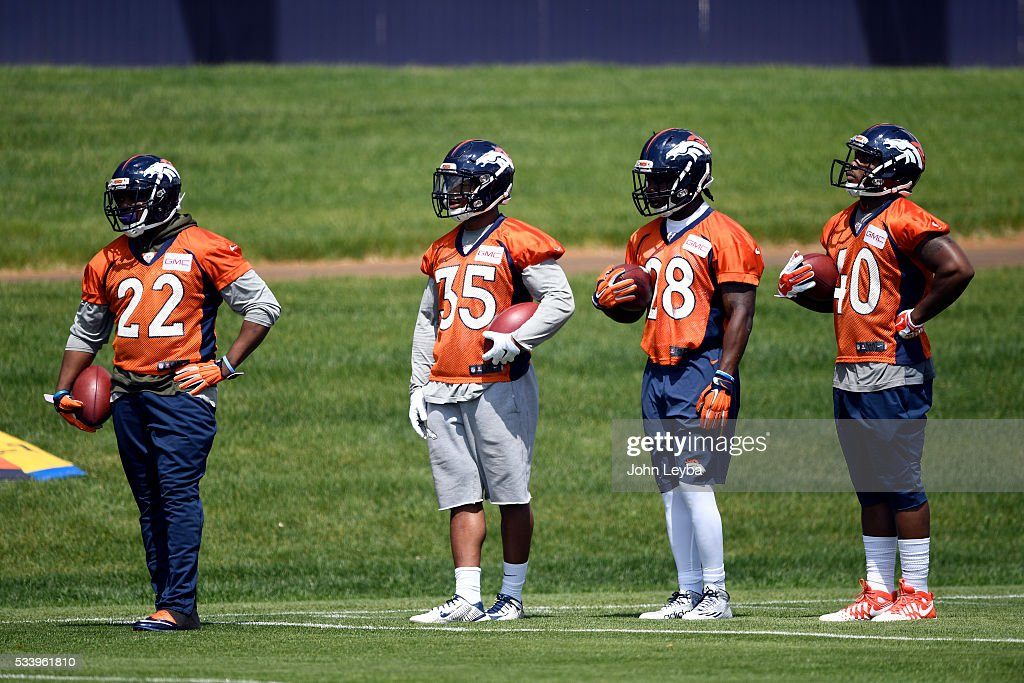Denver Broncos running backs C.J. Anderson (22) Kapri Bibbs (35) Cyrus Gray (28) and Juwan Thompson (40) look on during OTA's May 24, 2016 at UCHealth Training Facility.