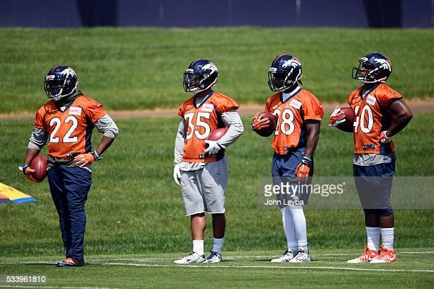 Denver Broncos running backs CJ Anderson Kapri Bibbs Cyrus Gray and Juwan Thompson look on during OTA's May 24 2016 at UCHealth Training Facility
