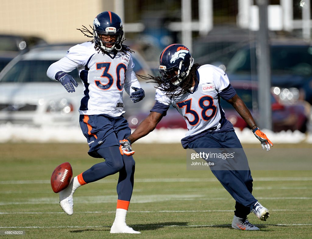 Denver Broncos strong safety <a gi-track='captionPersonalityLinkClicked' href=/galleries/search?phrase=David+Bruton&family=editorial&specificpeople=4023057 ng-click='$event.stopPropagation()'>David Bruton</a> (30) and Denver Broncos strong safety <a gi-track='captionPersonalityLinkClicked' href=/galleries/search?phrase=Quinton+Carter&family=editorial&specificpeople=5631827 ng-click='$event.stopPropagation()'>Quinton Carter</a> (38) work on drills during practice November 19, 2014 at Dove Valley.