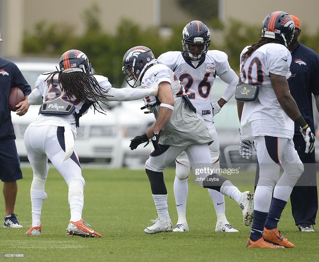Denver Broncos strong safety <a gi-track='captionPersonalityLinkClicked' href=/galleries/search?phrase=Quinton+Carter&family=editorial&specificpeople=5631827 ng-click='$event.stopPropagation()'>Quinton Carter</a> (38) and Denver Broncos strong safety John Boyett (20) run through drills on day seven of the Denver Broncos 2014 training camp July 31, 2014 at Dove Valley.