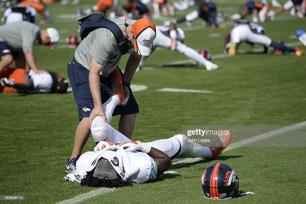 Denver Broncos strong safety <a gi-track='captionPersonalityLinkClicked' href=/galleries/search?phrase=Quinton+Carter&family=editorial&specificpeople=5631827 ng-click='$event.stopPropagation()'>Quinton Carter</a> (38) gets stretch on day five of the Denver Broncos 2014 training camp July 28, 2014 at Sports Authority Field at Mile High.