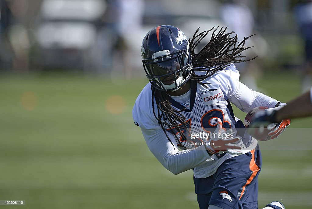Denver Broncos strong safety <a gi-track='captionPersonalityLinkClicked' href=/galleries/search?phrase=Quinton+Carter&family=editorial&specificpeople=5631827 ng-click='$event.stopPropagation()'>Quinton Carter</a> (38) runs through drills during the first day of the Denver Broncos 2014 training camp July 24, 2014 at Dove Valley.