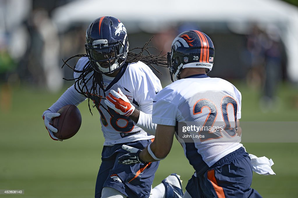 Denver Broncos strong safety <a gi-track='captionPersonalityLinkClicked' href=/galleries/search?phrase=Quinton+Carter&family=editorial&specificpeople=5631827 ng-click='$event.stopPropagation()'>Quinton Carter</a> (38) runs through drills with Denver Broncos strong safety John Boyett (20) during the first day of the Denver Broncos 2014 training camp July 24, 2014 at Dove Valley.