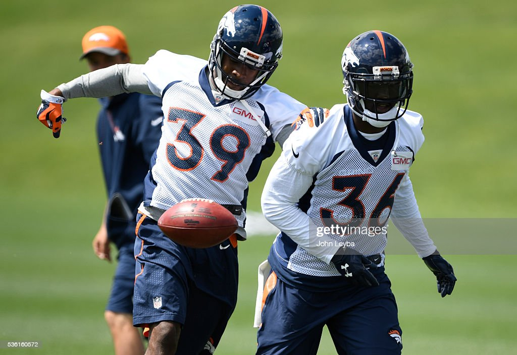 Denver Broncos <a gi-track='captionPersonalityLinkClicked' href=/galleries/search?phrase=Taurean+Nixon&family=editorial&specificpeople=7363200 ng-click='$event.stopPropagation()'>Taurean Nixon</a> (39) works on drills with <a gi-track='captionPersonalityLinkClicked' href=/galleries/search?phrase=Kayvon+Webster&family=editorial&specificpeople=6315925 ng-click='$event.stopPropagation()'>Kayvon Webster</a> (36) during OTA's May 31, 2016 at UCHealth Training Facility, Dove Valley.
